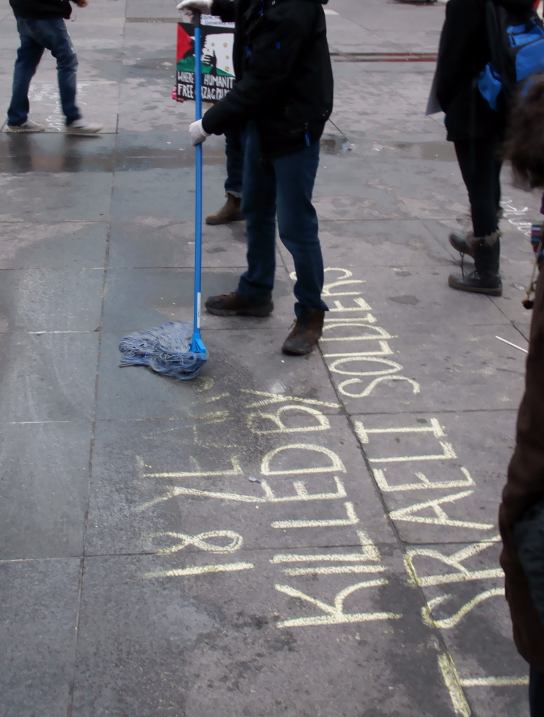 Worker mopping names of dead off Dundas Square