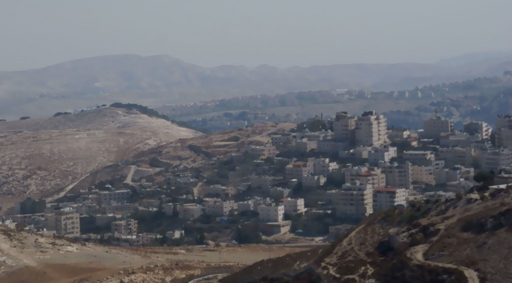West Bank with encroaching Israeli settlement in background