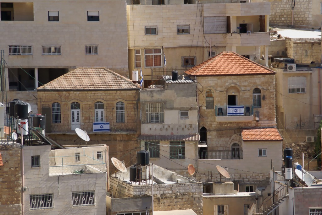 Houses in Silwan Valley displaying Israeli flags